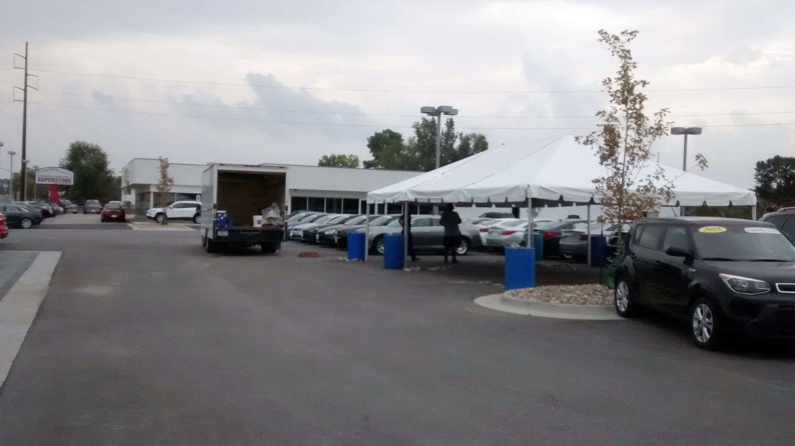 Setting up 20′ x 30′ frame tent for the grand re-opening at Coralville Used Car Superstore