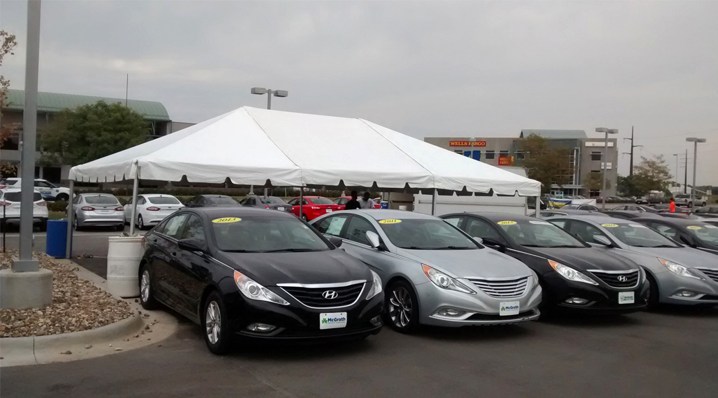 Tent event for the grand re-opening at Coralville Used Car Superstore