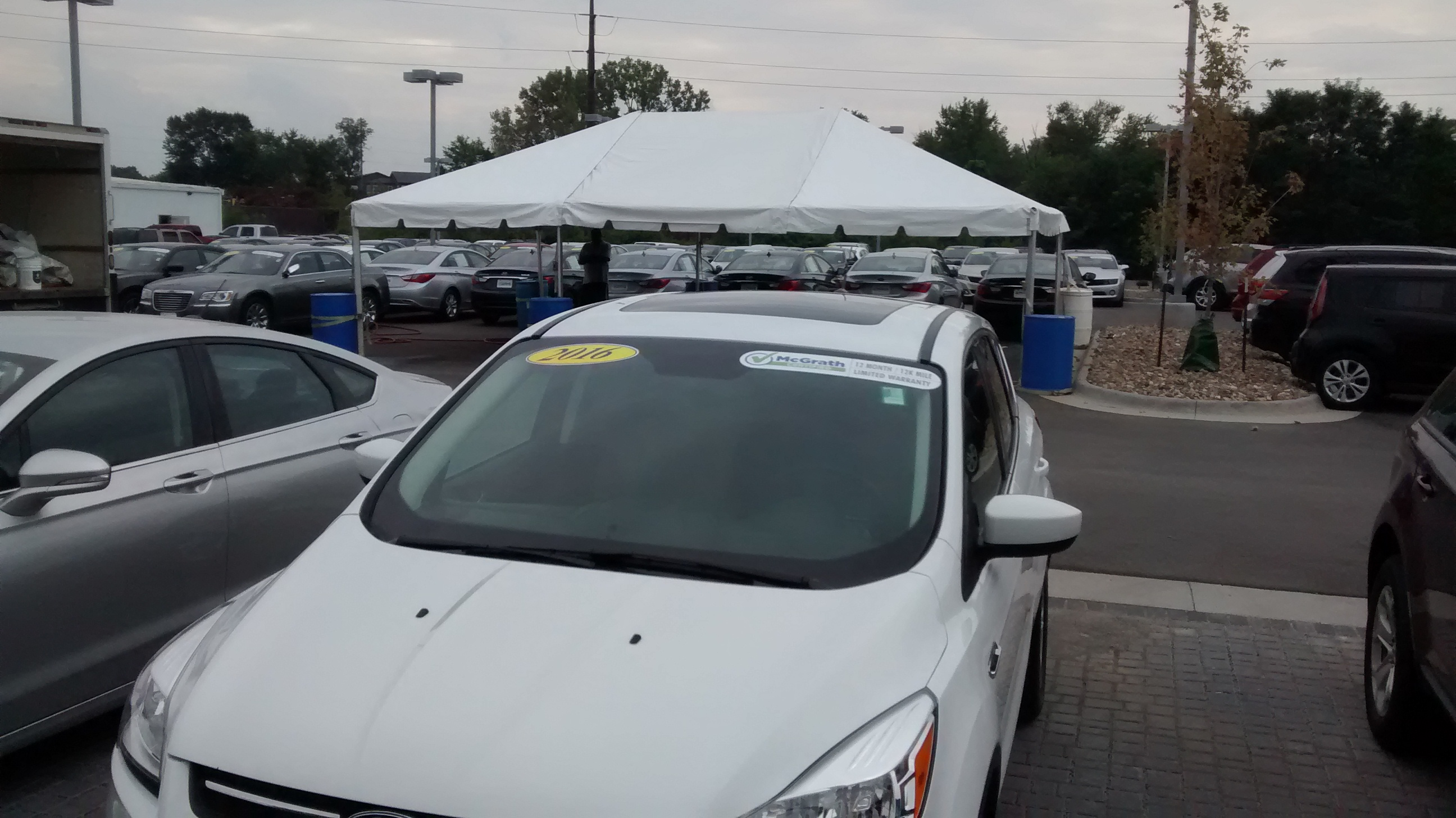 View by cars at 20′ x 30′ frame tent for the grand re-opening at Coralville Used Car Superstore