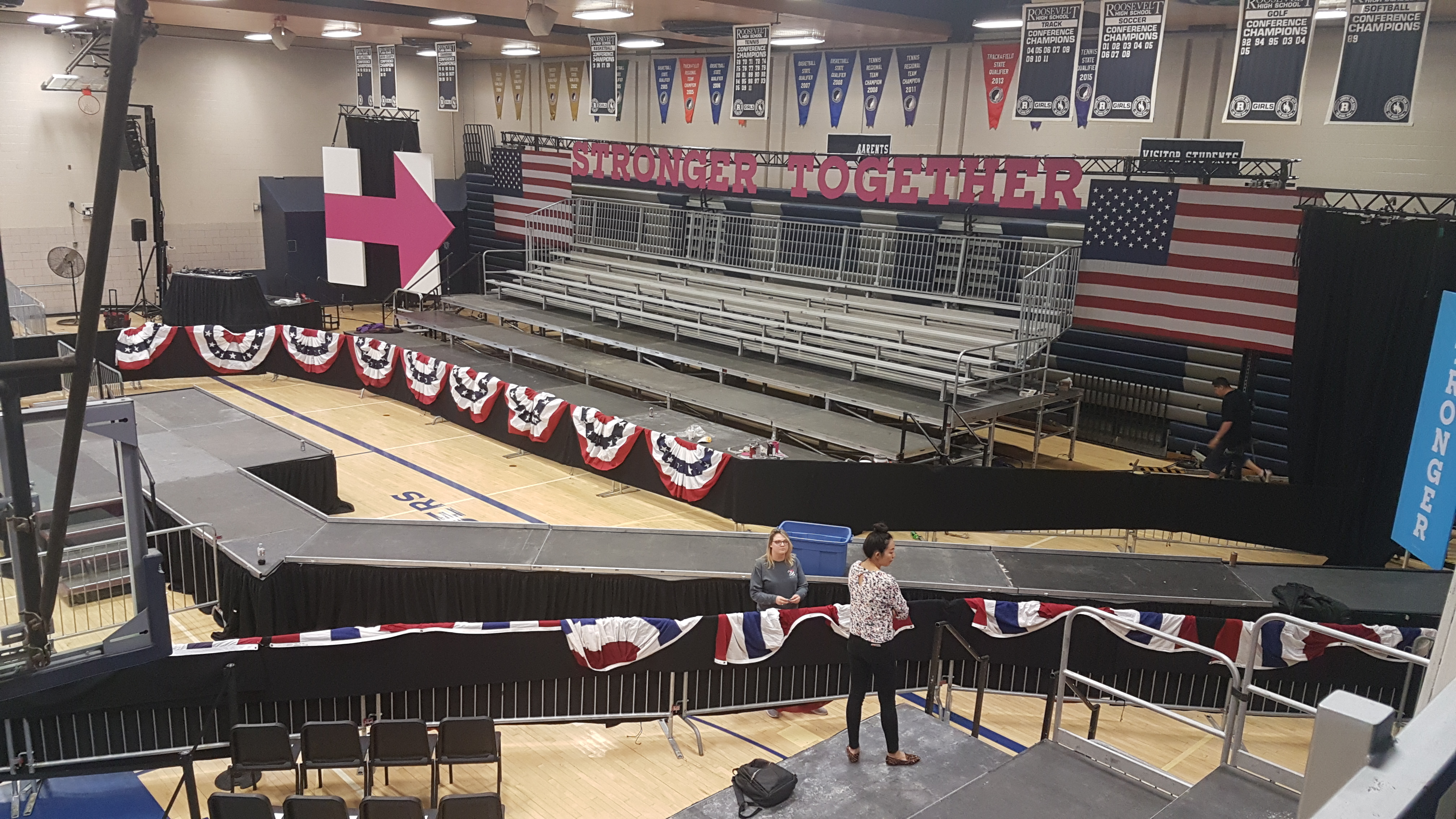 Elevated stage and catwalk with 45 degree turn for Hillary Clinton political rally in Des Moines at Pomerantz Gymnasium