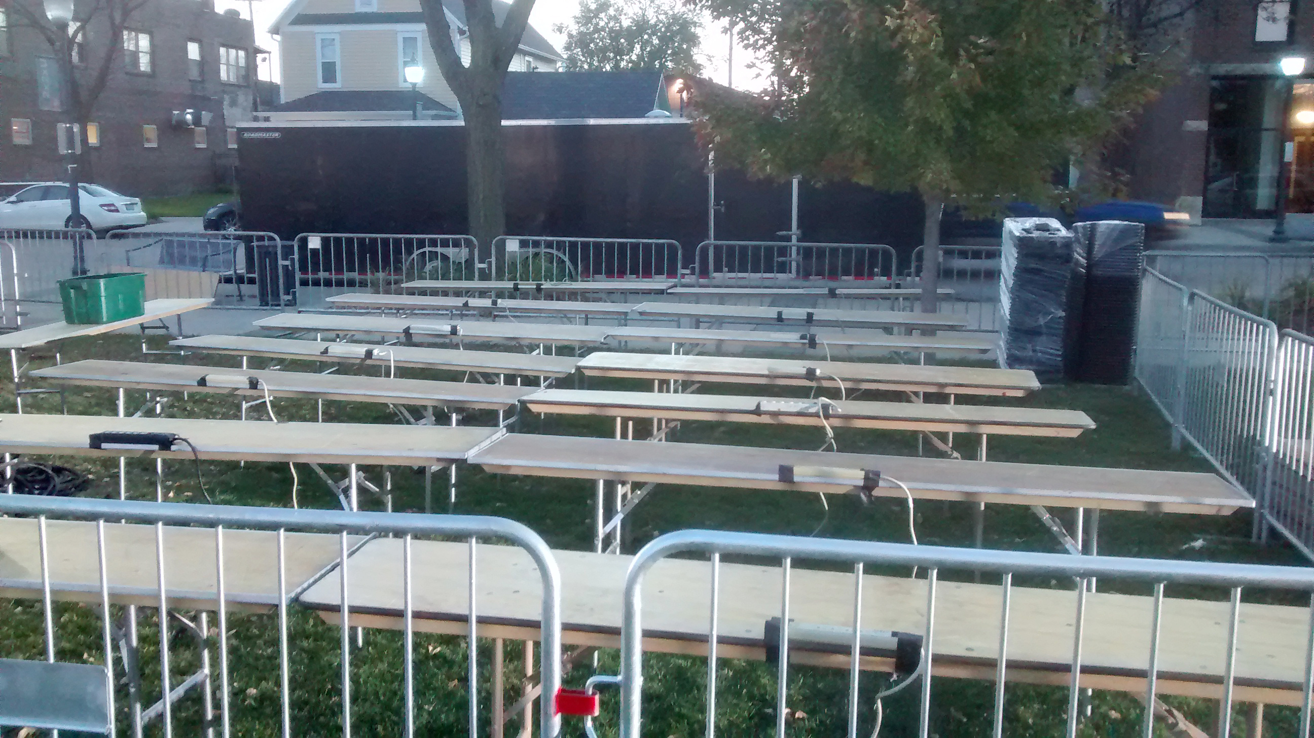 Press box with chairs, tables, barricade for the Hillary Clinton political rally at NewBo City Market in Cedar Rapids, Iowa