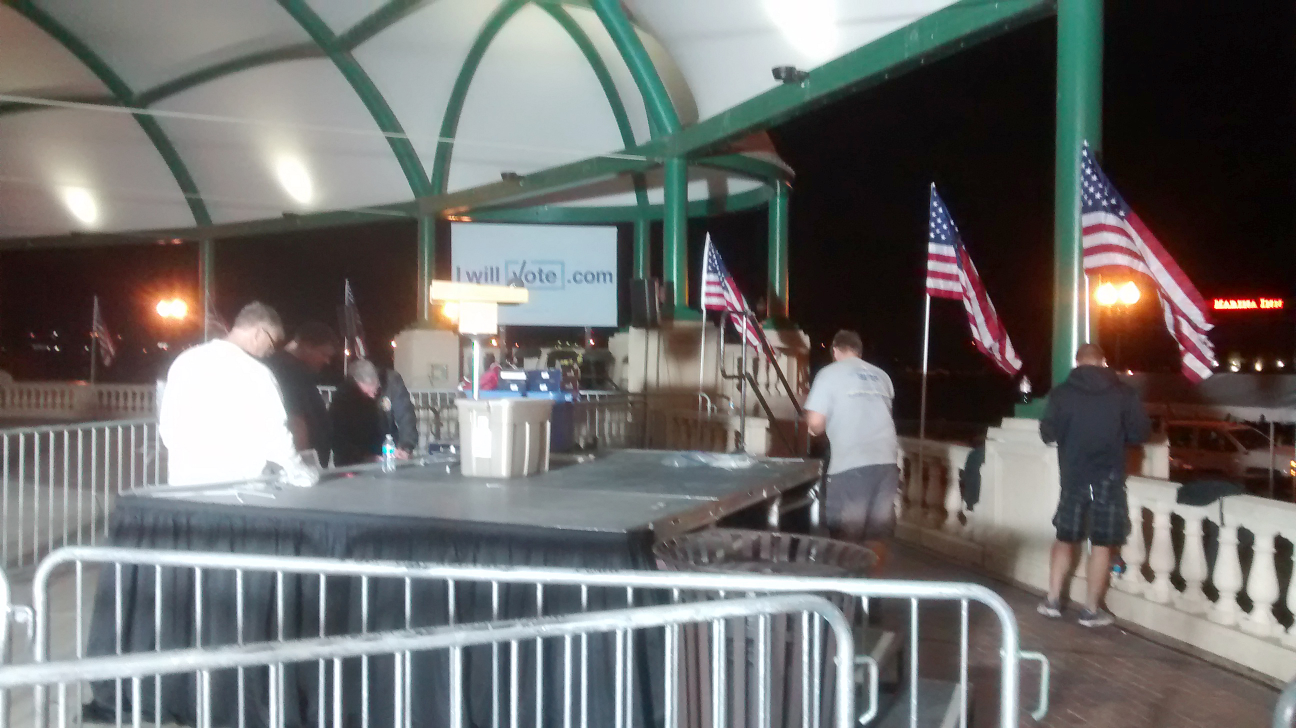 Stage with flags for political event at Larsen Park Road, Sioux City, Iowa
