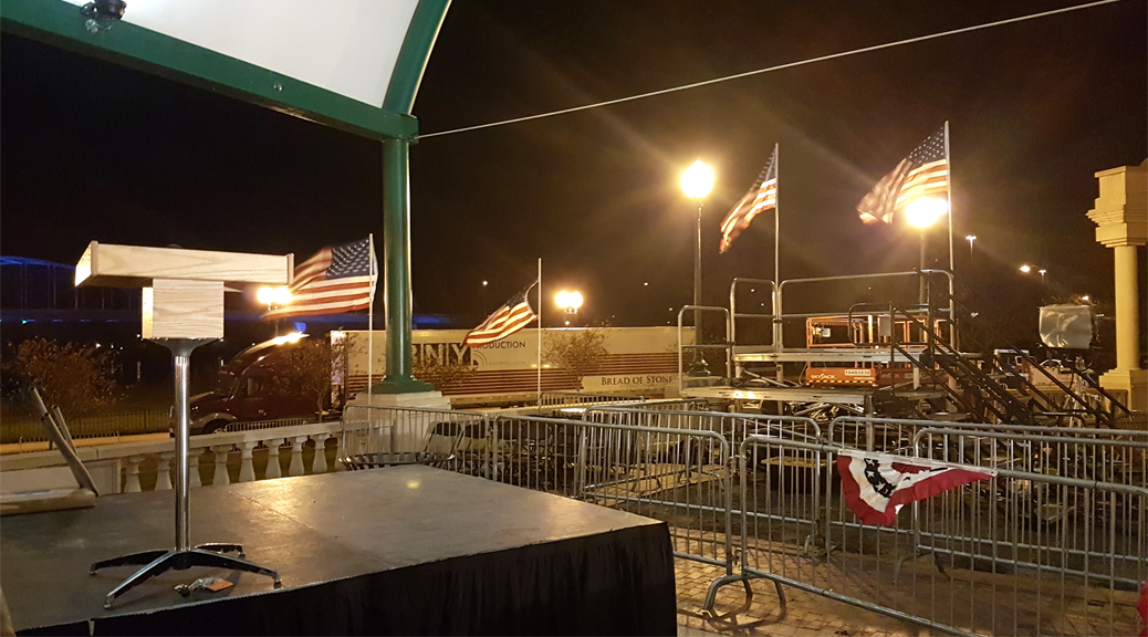 We setup the podium, stage, barricade and in the background press risers with stairs for this political event at Larsen Park, Sioux City, Iowa