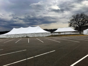 40' x 100' Elite rope and pole tent (left), 20' x 40' rope and pole tent (middle), 30' x 60' rope and pole tent (right) for Special Olympics Polar Plunge