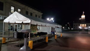 10' x 30' frame tent set up at night for an event