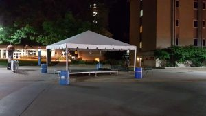 20' x 20 frame tent with stage set up at night