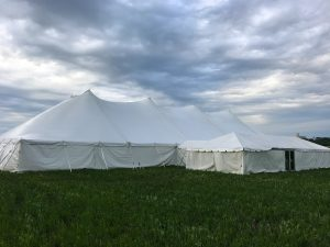 80' x 150' Twin Pole rope and pole tent with 20' x 60' frame tent with a glass door