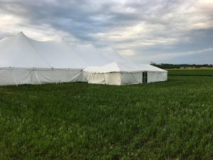 80' x 150' rope and pole tent with a 20' x 60' frame tent with a glass door connected by a 10' x 10' frame tent
