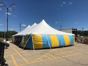 End of White top 30' x 60' rope and pole (one piece) tent for Kaboomers fireworks Des Moines, Iowa with blue and yellow side walls