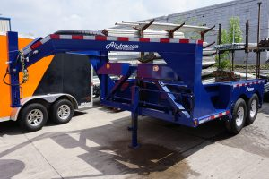 Gooseneck Hitch on the Tandem Axel Airtow Drop-Deck flatbed Trailer for rent in Iowa