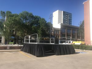 Setup of our 16' x 16' stage on 48 legs in downtown Iowa City for the Iowa City Block Party in 2017