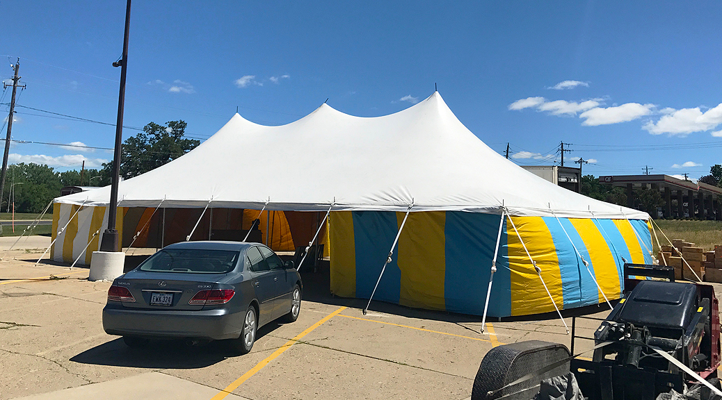 White top 30' x 60' rope and pole (one piece) tent for Kaboomers fireworks Des Moines, Iowa with blue and yellow side walls