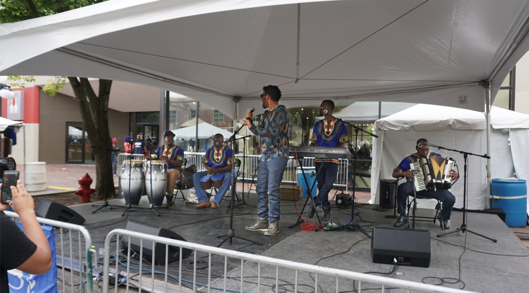 Band on tented stage at the 2017 Iowa Soul Festival in Iowa City. IA (Summer of the Arts)