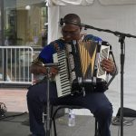 Man playing the Accordion at the 2017 Iowa Soul Festival in Iowa City. IA (Summer of the Arts)