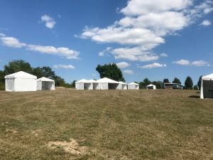 Multiple tents for an Outdoor corporate event setup for West Liberty foods in Libertyville, Iowa