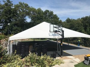 40' x 60' hybrid event tent setup on a Basketball court in Coralville