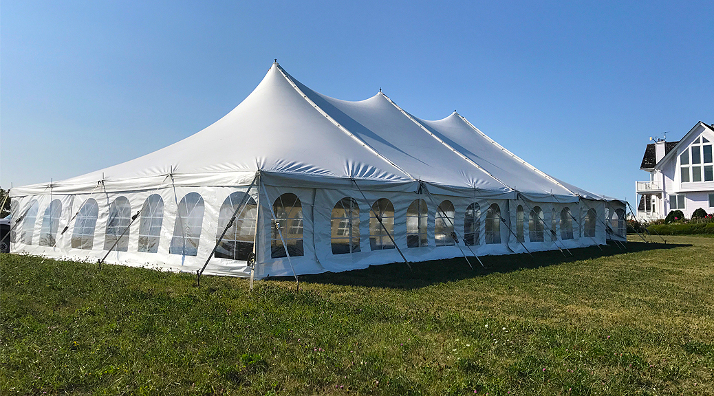 40' x 80' rope and pole wedding tent setup in Fairfield, Iowa
