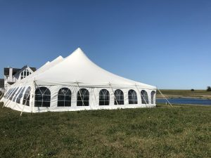 End of 40' x 80' rope and pole wedding tent setup in Fairfield, Iowa