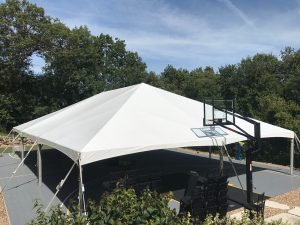 End of the 40' x 60' hybrid event tent setup on a Basketball court in Coralville
