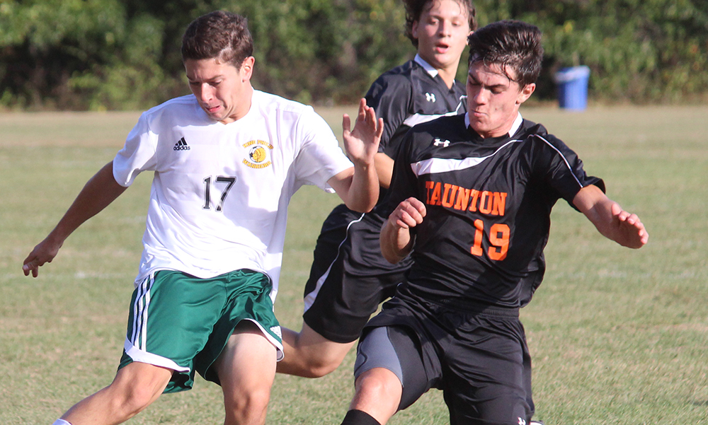 King Philip's Ryan Ackles and Taunton's Luke Figueira battle for possession. (Ryan Lanigan/HockomockSports.com)