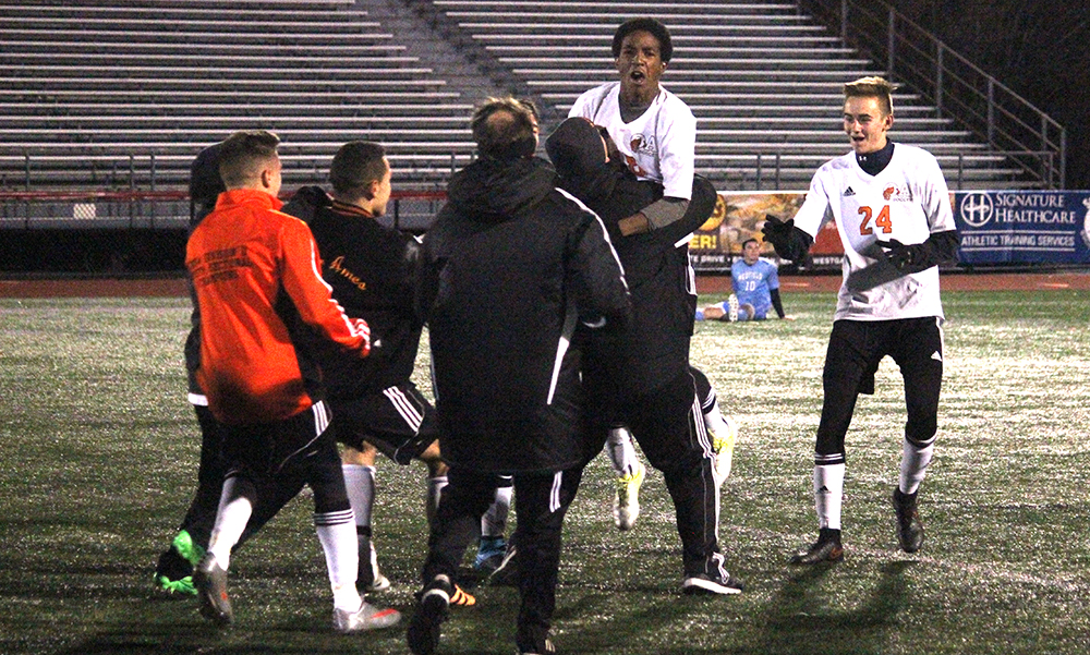 Oliver Ames sophomore Nathaniel Cardoza celebrates after scoring the game winner in the second overtime. (Ryan Lanigan/HockomockSports.com)