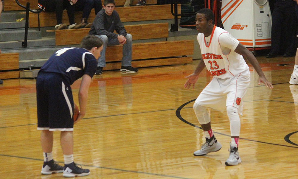 Oliver Ames' Charlie Ryan (right) defends an Archbishop Williams player in the first half. (Ryan Lanigan/HockomockSports.com)