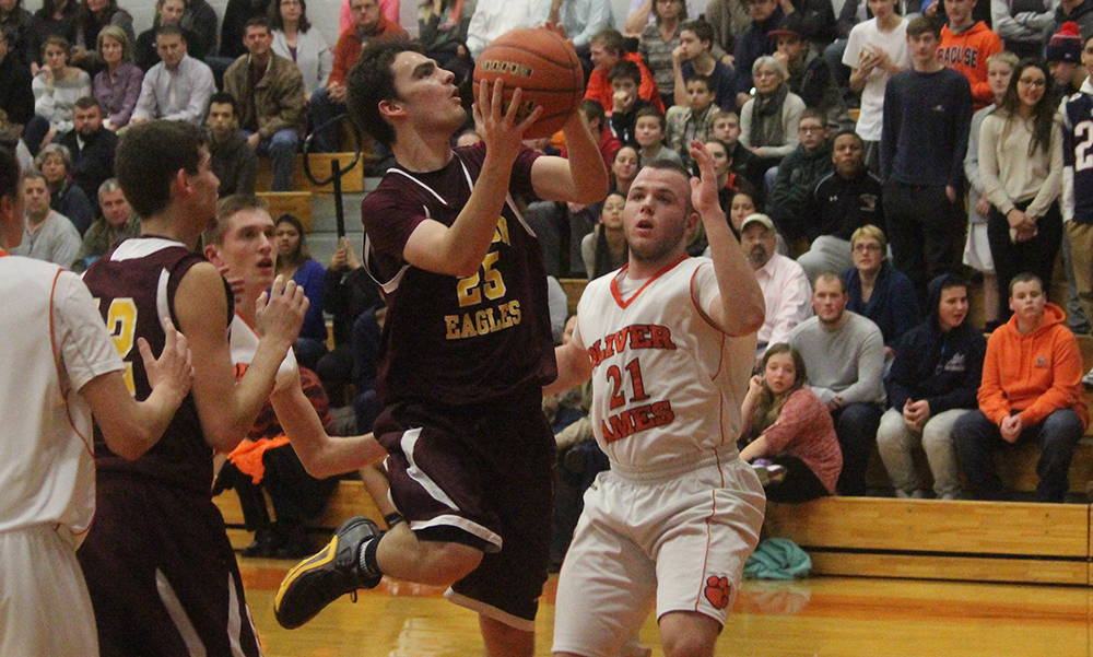Sharon's Matt Lowerre drives to the basket in the first half against Oliver Ames. (Ryan Lanigan/HockomockSports.com)