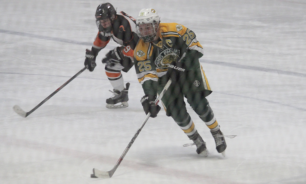 King Philip senior defenseman Clay Geuss handles the puck through the neutral zone in the second period. (Ryan Lanigan/HockomockSport.com)