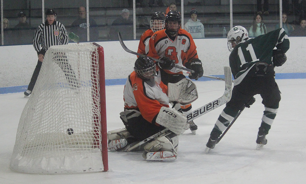 Canton's Jack Goyetch (11) and OA goalie Zach Walsh watch as Jim Jenkins' (not pictured) shot fins the back of the net. (Ryan Lanigan/HockomockSports.com)
