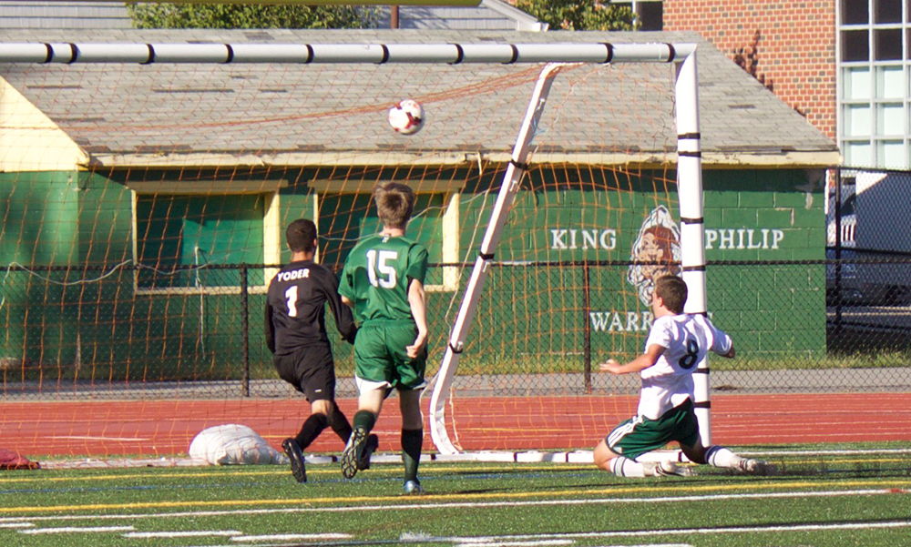King Philip's Zac White (8) watches as his shot finds the back of the net for the lone goal. (Jaron May/HockomockSports.com
