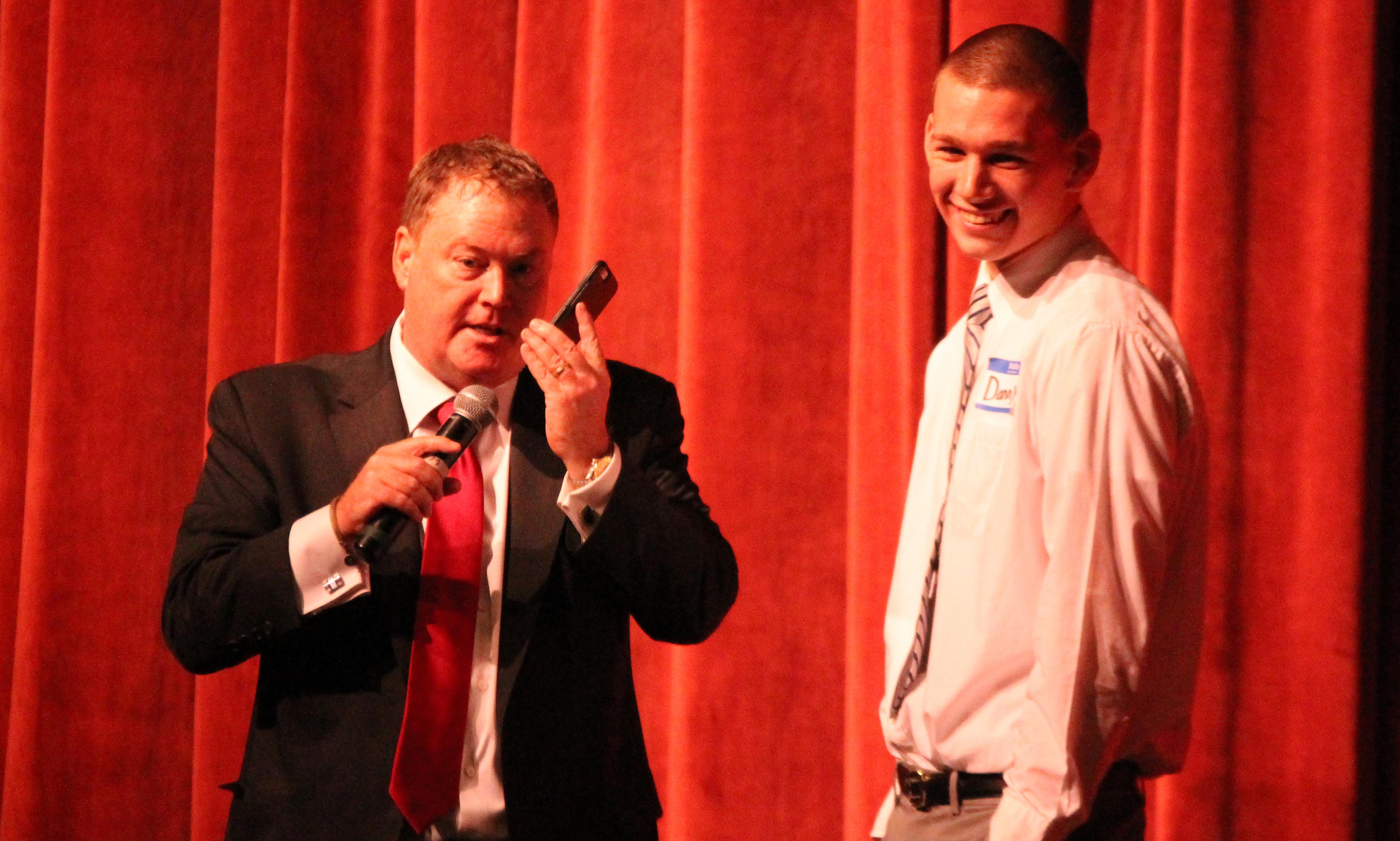 Motivational speaker Ed Gerety talks on Taunton's Danny Keogh's phone during his presentation on Wednesday. (Ryan Lanigan/HockomockSports.com)