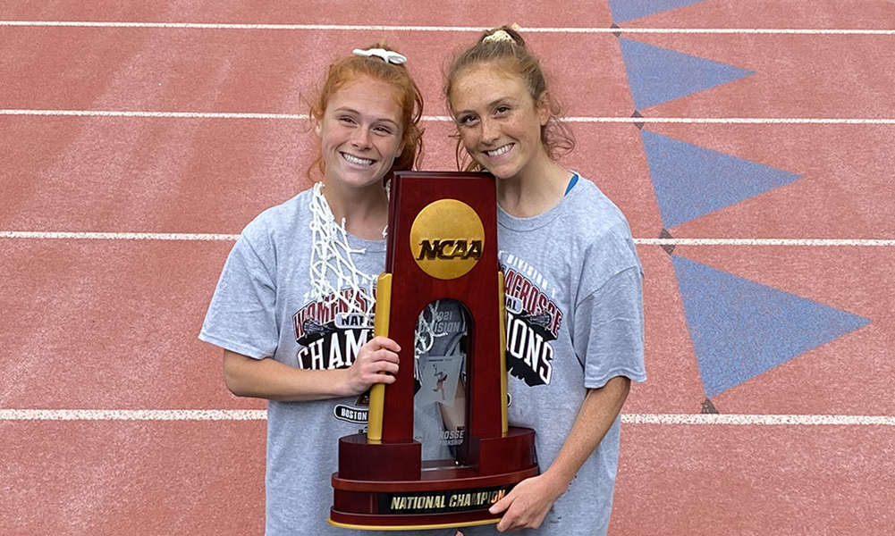 ranklin grads Erin (left) and Annie Walsh hold the championship trophy after Boston College women's lacrosse beat Syracuse to win the program's first-ever national title. (Courtesy of Annie Walsh)