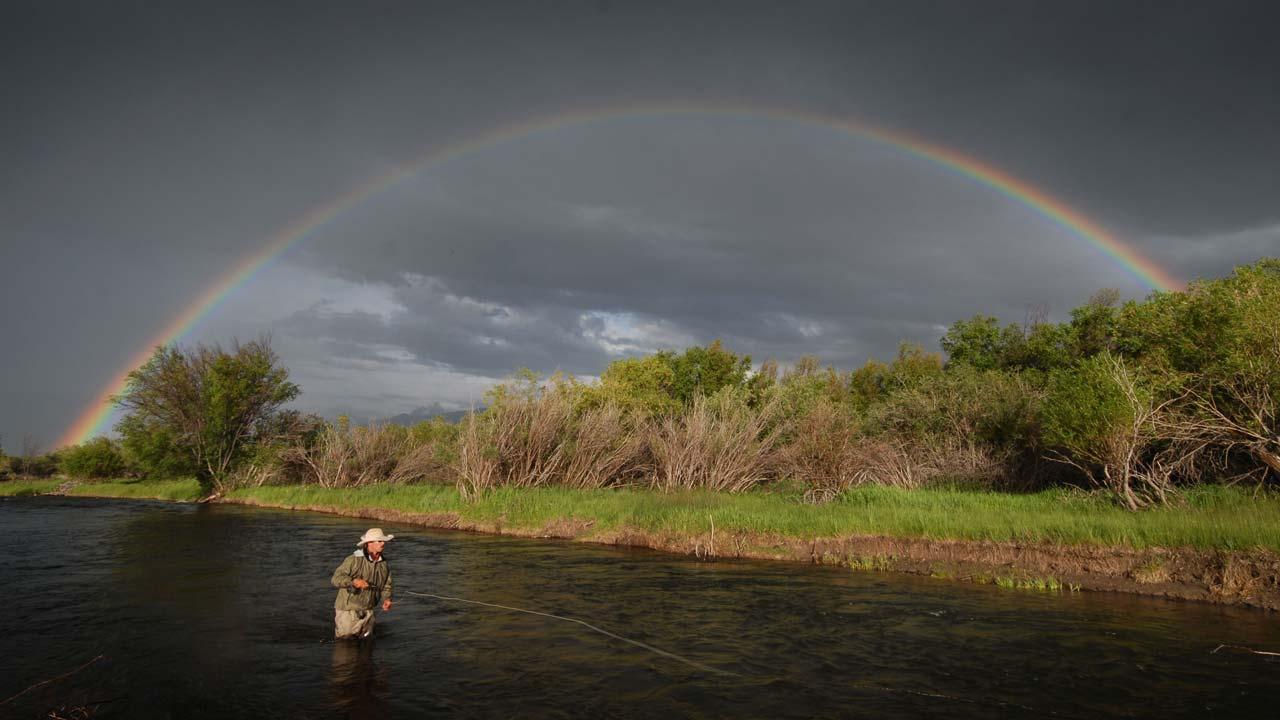 Rainbow over Angler on Madison River, Montana