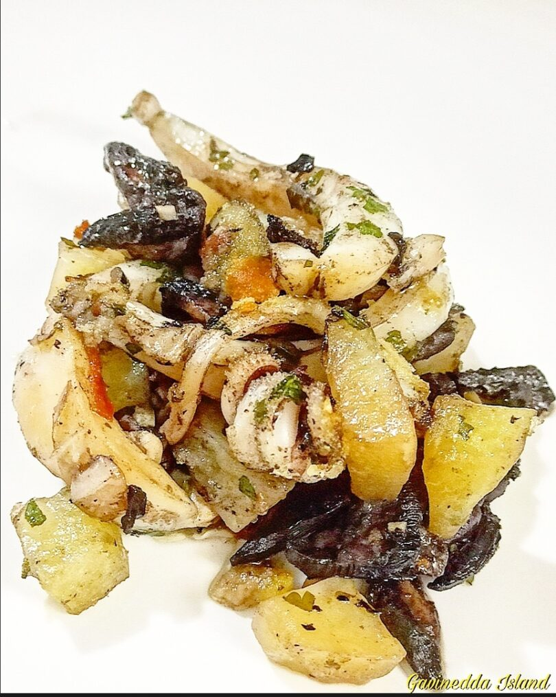 Seppie al forno con champignon e patate