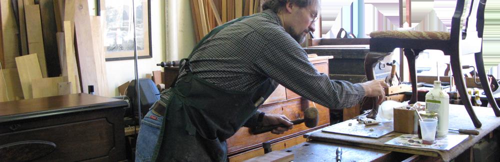 Erick Clingen restoring an antique chair in his Westchester County workshop
