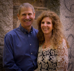 Photo of Pastor Ric and KD in front of a stone wall
