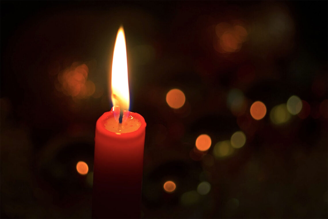 photo of a red, burning, Christmas candle