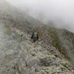 photo of man hiking knifes edge alone
