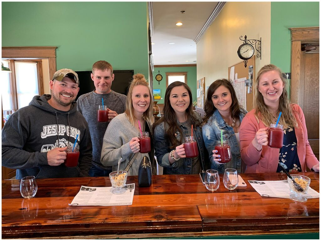 CB Studio Brides Reunion wine tasting event held at Train Wreck Winery in Algona, IA. Group shot with our wine slushies.