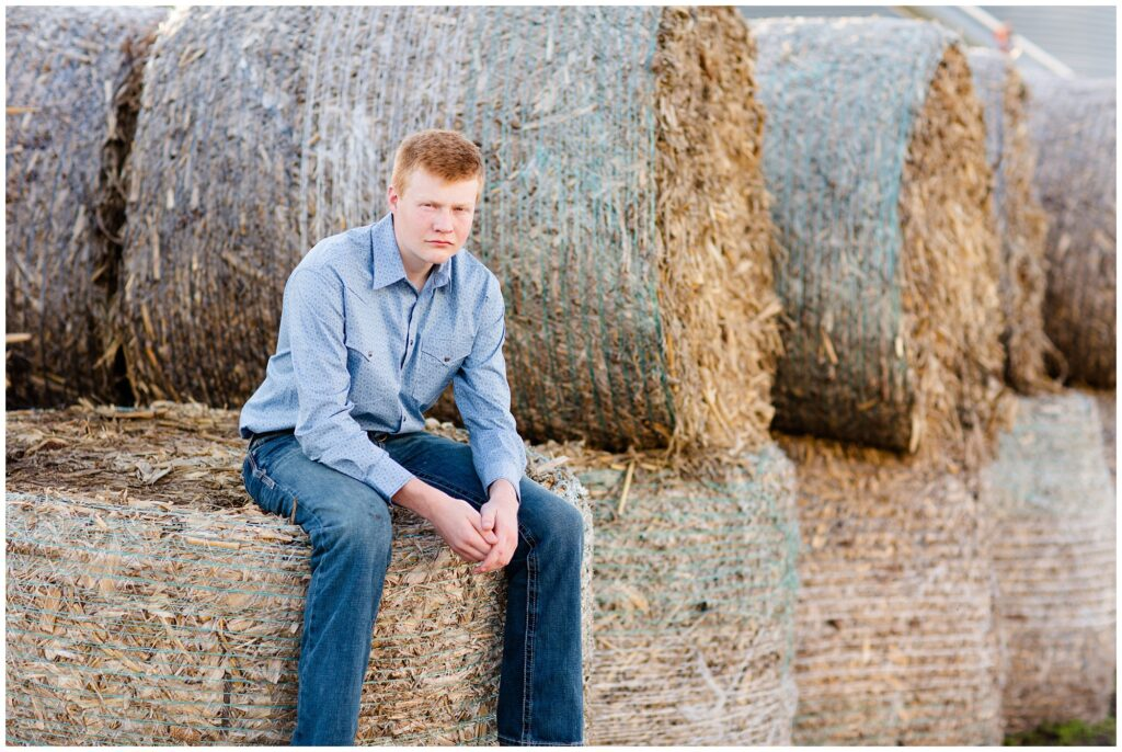 Senior photo on hay bales | Farm senior session | Iowa Senior Photographer | CB Studio