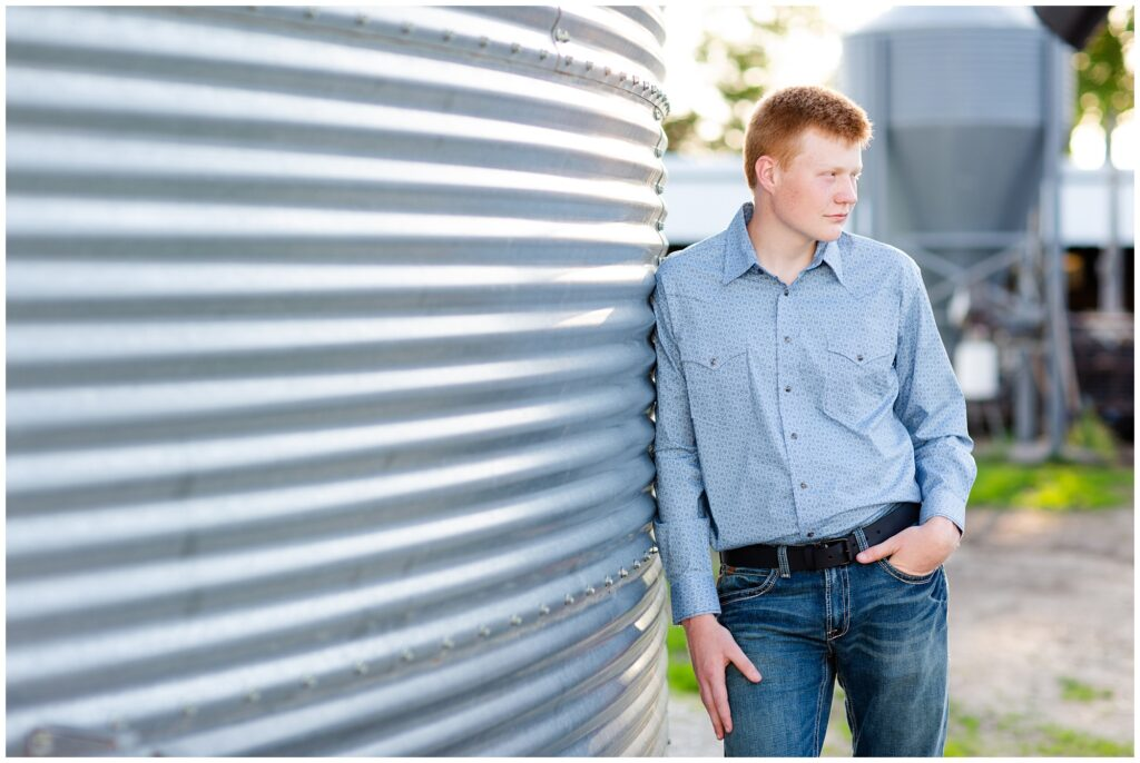 Senior photo by grain bin | Farm senior session | Iowa Senior Photographer | CB Studio