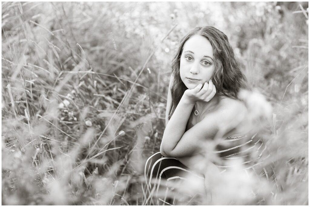 Senior photos open grassy field with a jacket   senior poses   Iowa Senior Photographer   CB Studio