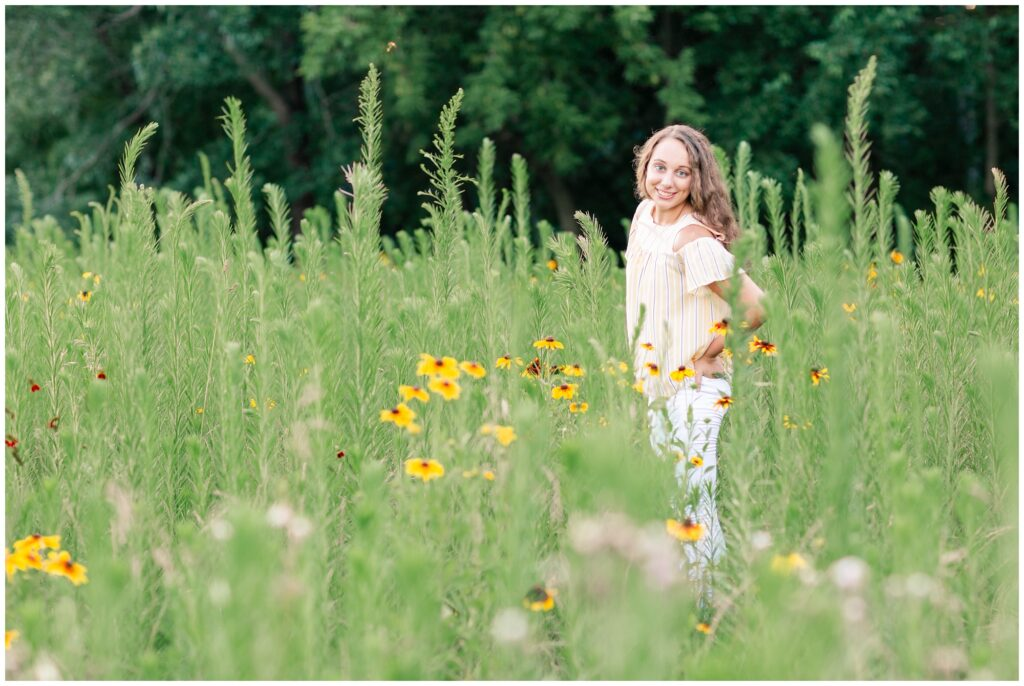 Senior photos open grassy flower field   senior poses   Iowa Senior Photographer   CB Studio