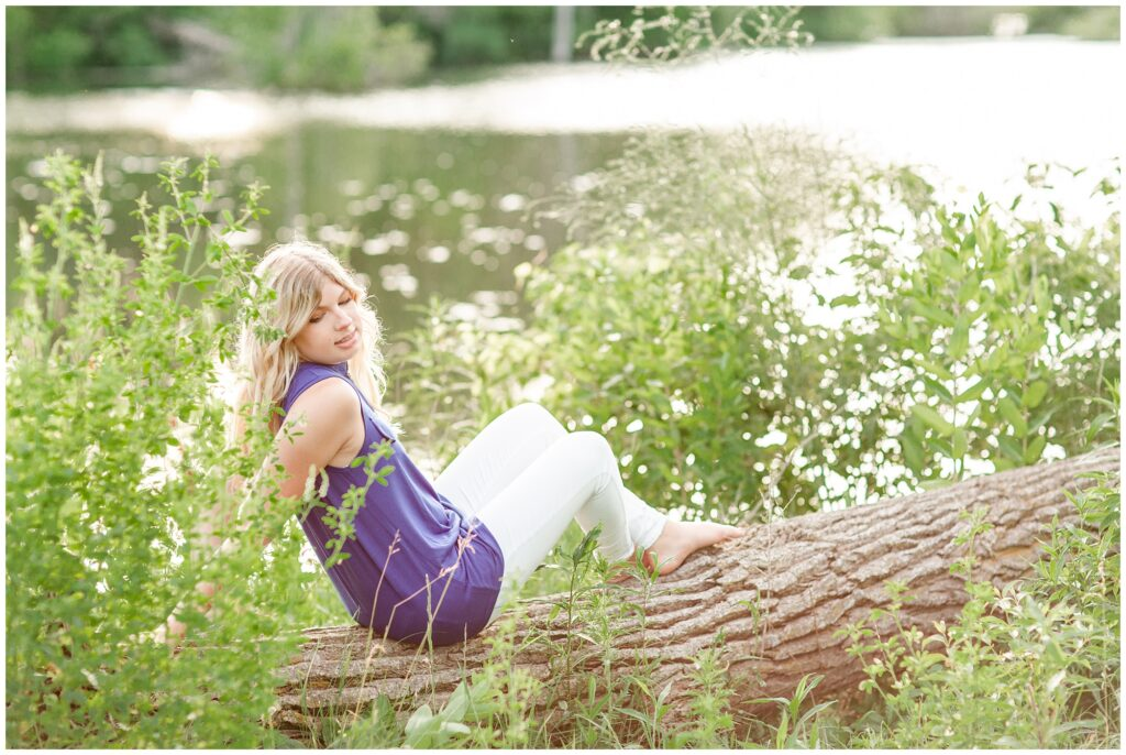 Senior portrait session at a park during golden hour   Senior girl poses by a lake   Iowa Senior Photographer   CB Studio