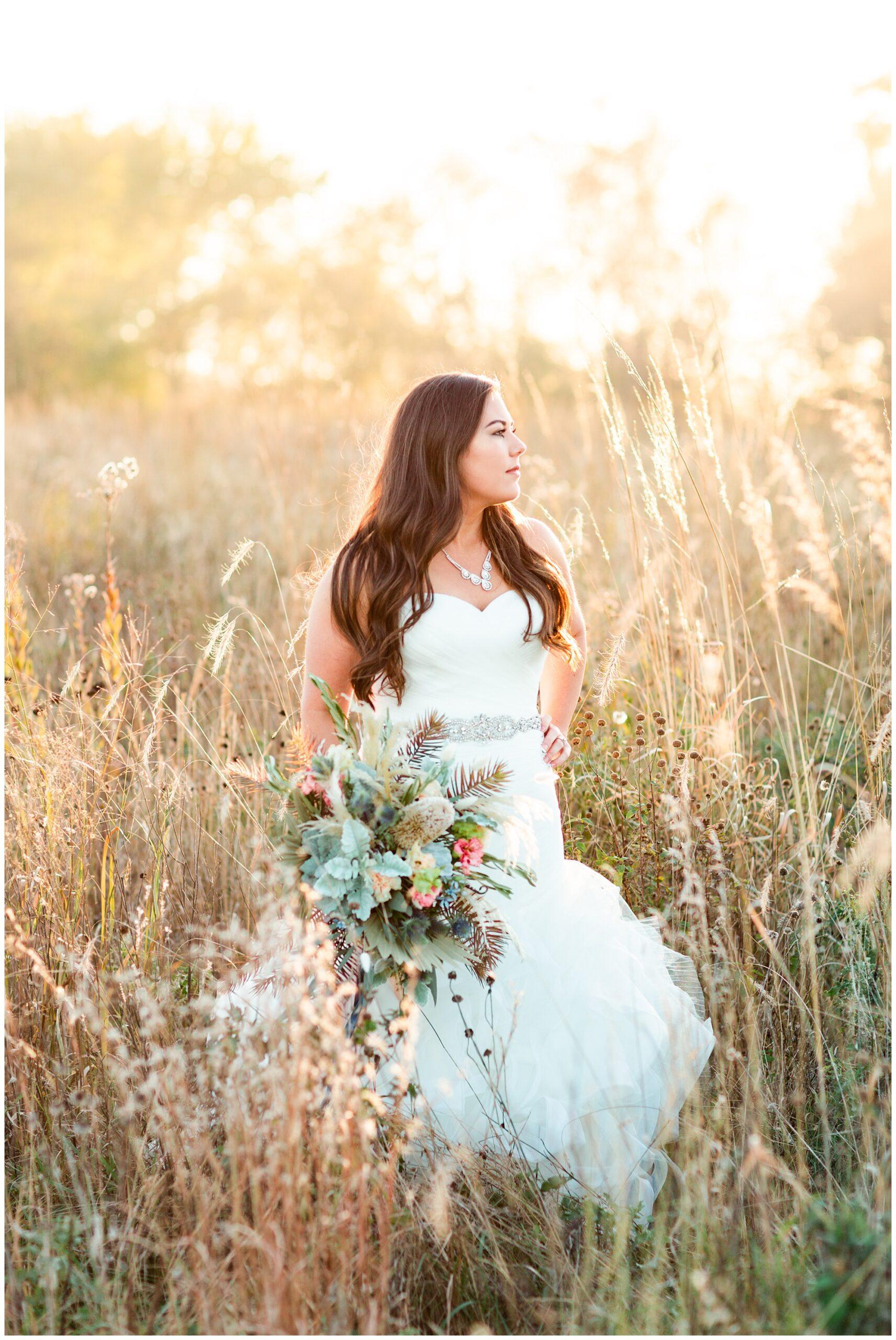 Fall bridal portrait in a tall grassy field