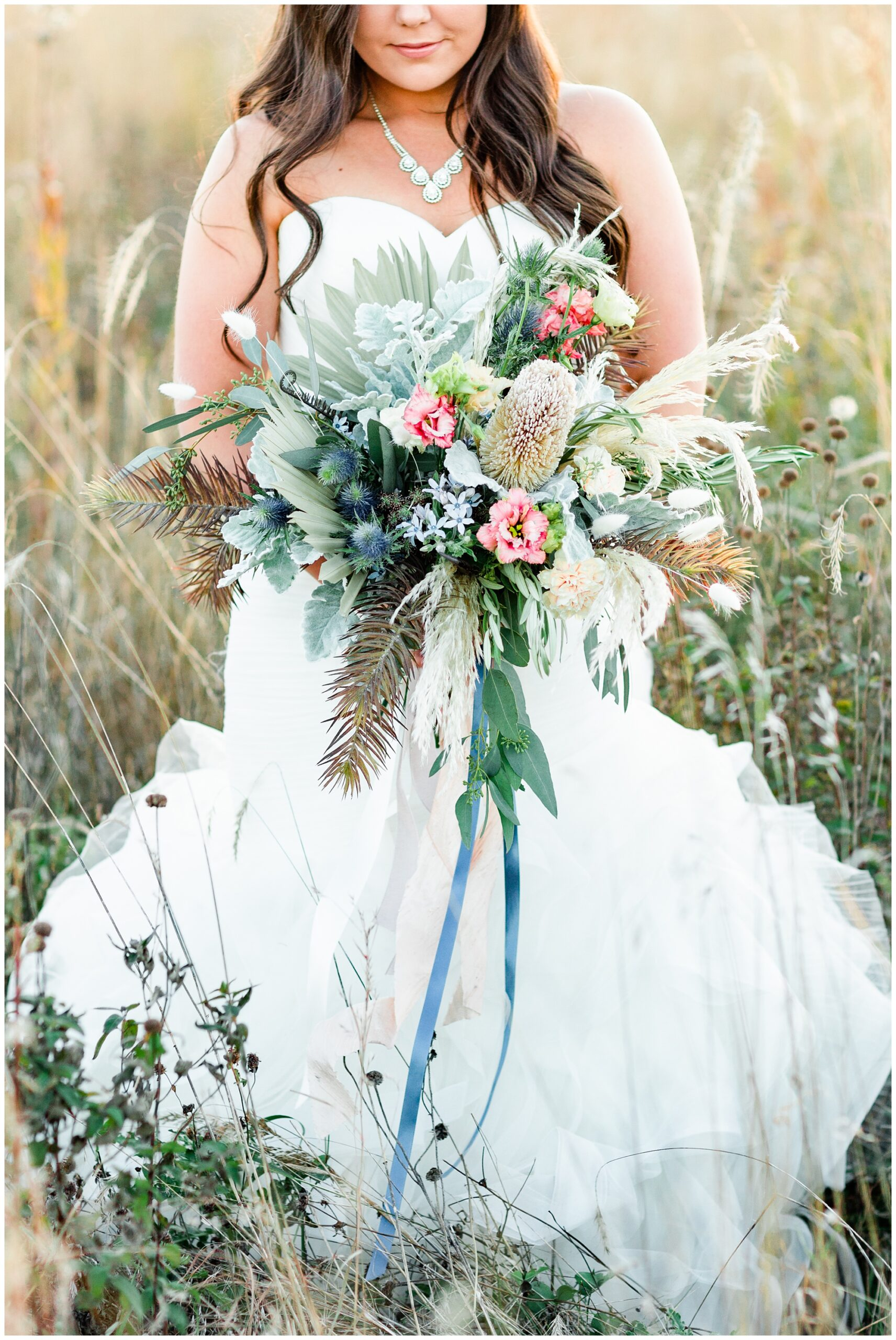 Trendy bridal boquet with a variety of florals with soft colors