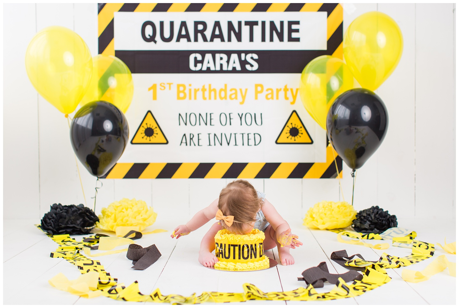 Quarantined themed cake smash complete with caution tape and yellow and black balloons | CB Studio