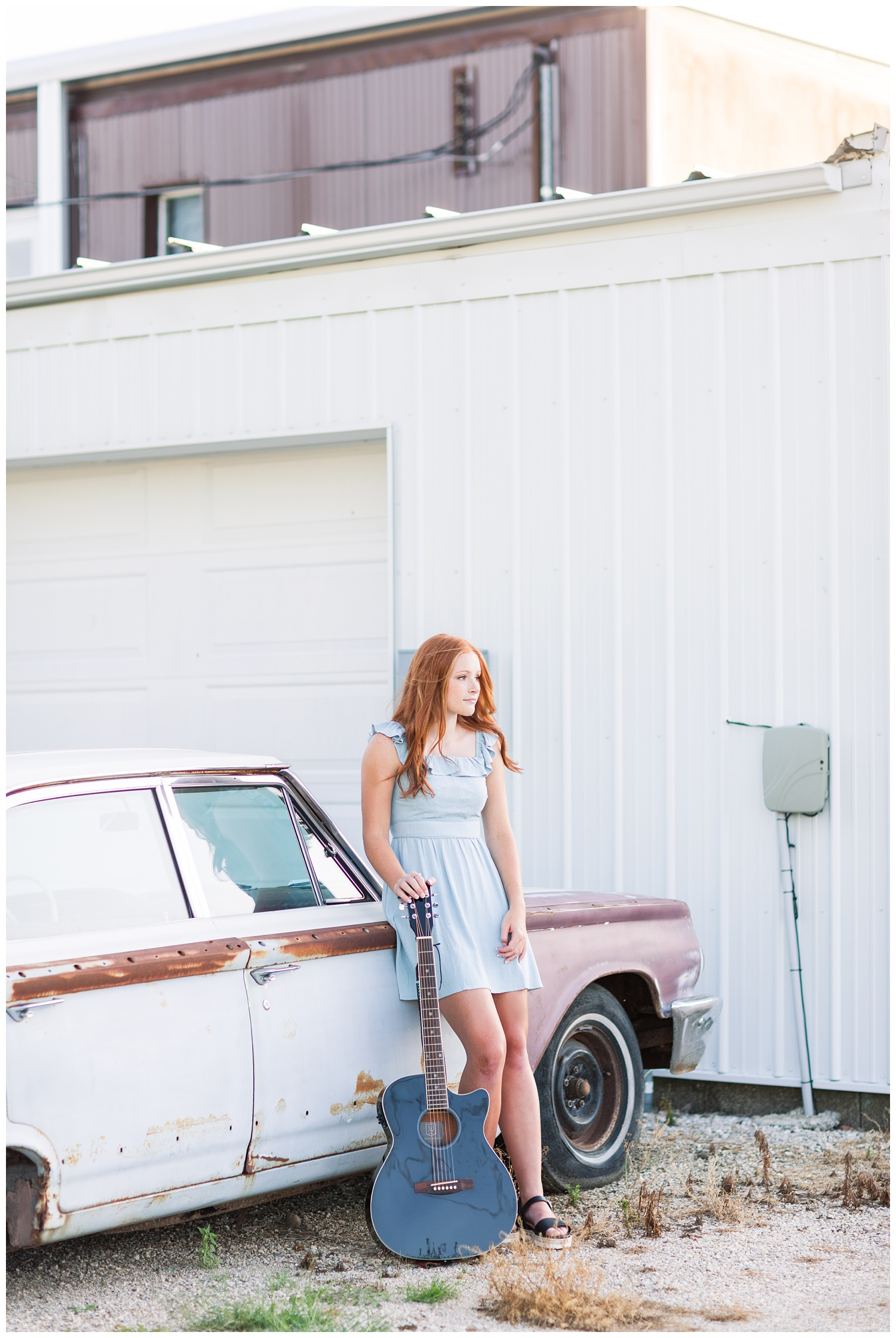 Senior girl leaning against a rustic, vintage car with her guitar in West Bend, Iowa | CB Studio