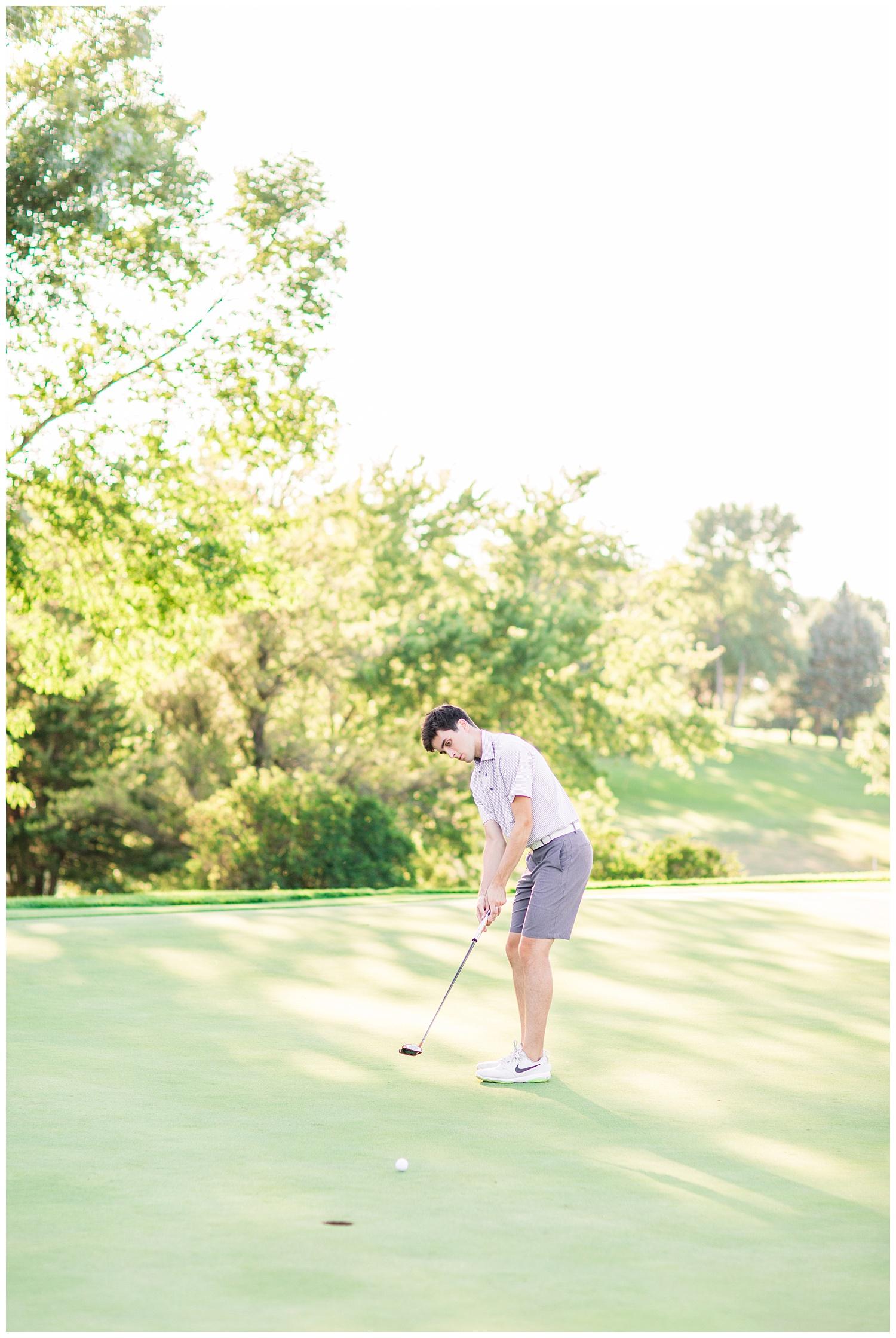 High school senior boy putting a golf ball at Spring Vally Golf Course in Livermore, Iowa | CB Studio
