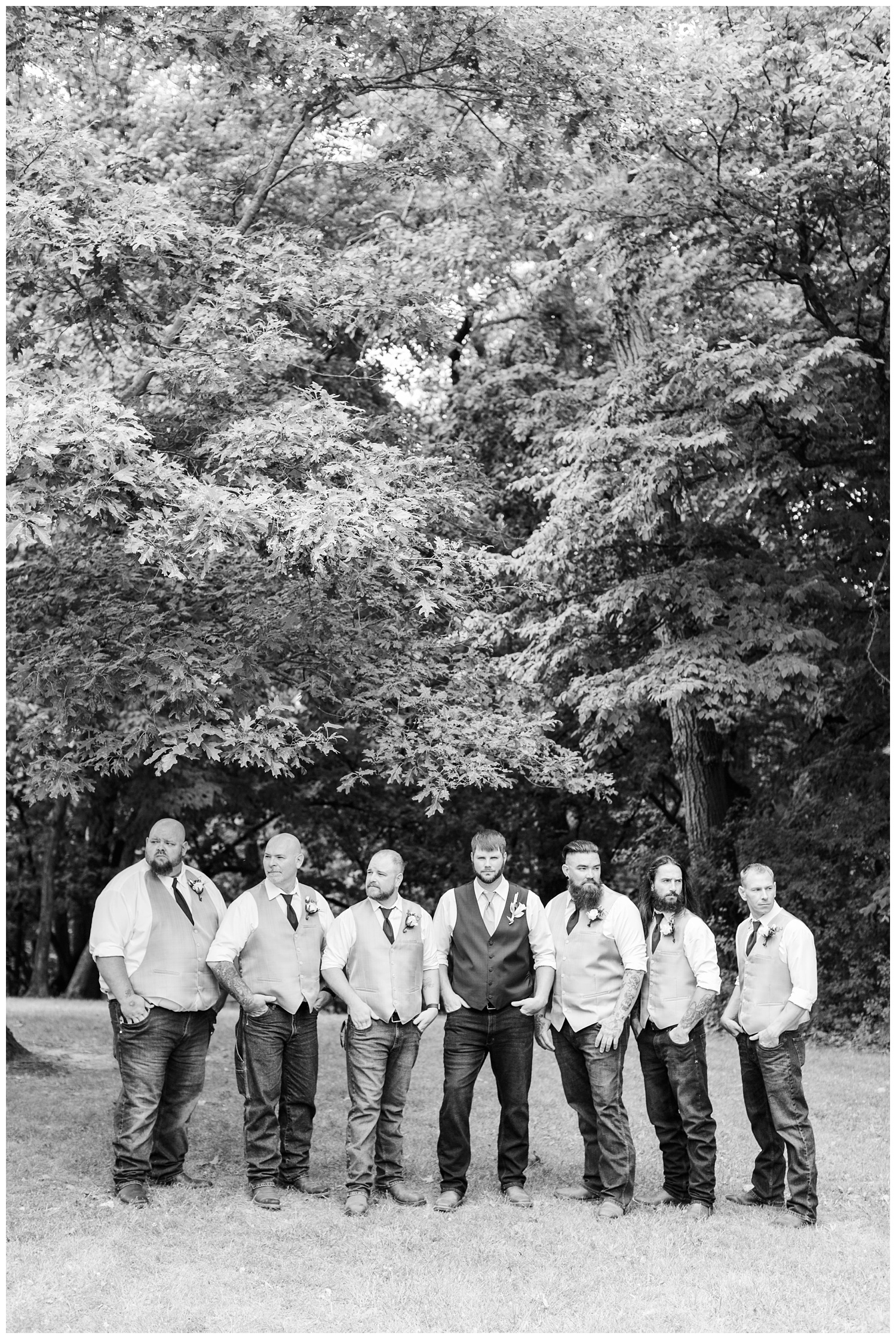 Groomsmen stand with model face at Call Park in Algona, Iowa   CB Studio